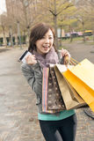 Asian woman take credit card hold shopping bags Stock Photo