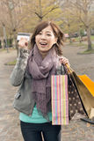 Asian woman take credit card hold shopping bags Stock Photography
