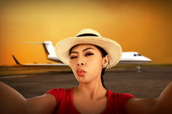 Asian woman take selfie on the airport Royalty Free Stock Image