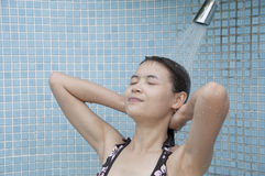 Asian woman take a shower. Royalty Free Stock Photos