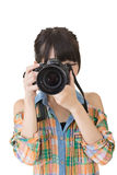 Asian woman takes images with photo camera Royalty Free Stock Images