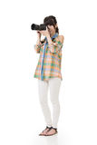 Asian woman takes pictures with photo camera Stock Photo