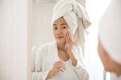 Asian woman taking care her face stock photography