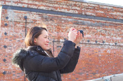 Asian woman taking photos Stock Photos
