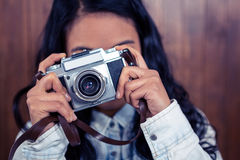 Asian woman taking picture with digital camera Royalty Free Stock Images