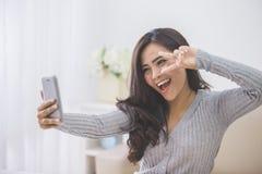 Asian woman taking selfie Royalty Free Stock Photos