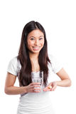 Asian woman taking vitamins Stock Photography