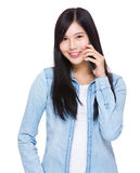 Asian woman talk to cell phone. Isolated on white background Royalty Free Stock Image