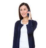 Asian woman talk to cellphone Stock Photography