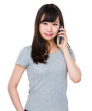 Asian woman talk to cellphone Royalty Free Stock Photo