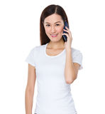Asian Woman talk to cellphone Stock Images