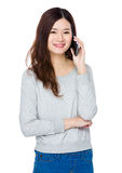 Asian woman talk to mobile phone. Isolated on white background Stock Image