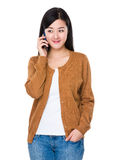Asian woman talk to mobile phone Stock Images