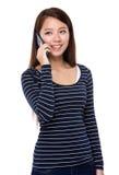 Asian woman talk to phone Stock Photo