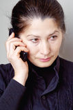 Asian Woman Talking On The Phone Royalty Free Stock Photography