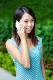 Asian woman talking phone Royalty Free Stock Photo
