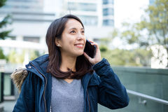 Asian woman talking on phone Royalty Free Stock Image