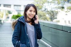 Asian woman talking on the phone Royalty Free Stock Photos