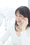 Asian woman talking with smart phone Stock Photo