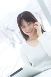 Asian woman talking with smart phone Royalty Free Stock Photos