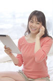 Asian woman talking with smart phone Stock Image