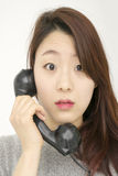 Asian woman talking by telephone Stock Images