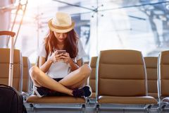 Free Asian Woman Teenager Using Smartphone At Airport Royalty Free Stock Image - 114455666