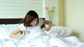 Asian woman teenager wake up and relaxation in bed stock video footage