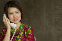 Asian woman with telephone Stock Photography