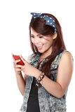 Asian Woman text on her cellphone Stock Photo