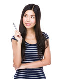 Asian woman think of idea with holding a pen Stock Image