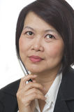 Asian woman thinking Royalty Free Stock Images