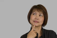 Asian woman thinking Stock Photo