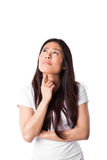 Asian woman thinking. An isolated shot of a beautiful asian woman thinking Royalty Free Stock Photography