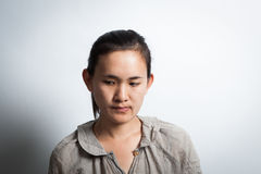 Asian woman thinking. Royalty Free Stock Photos