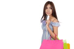 Asian woman thinking show a credit card with shopping bags Stock Photo