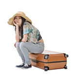 Asian woman thinking and sitting on a luggage Royalty Free Stock Image