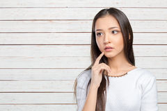 Asian woman thinking Royalty Free Stock Photography