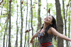 Asian woman Throw leaves. In autumn stock image