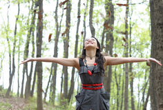 Asian woman Throw leaves. In autumn royalty free stock image