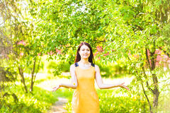 Asian woman throwing  petals in spring garden Royalty Free Stock Image