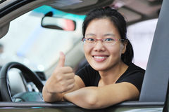 Asian woman thumb up in car Royalty Free Stock Images