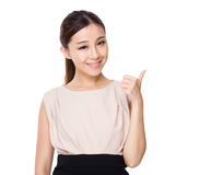 Asian woman with thumb up gesture Royalty Free Stock Images