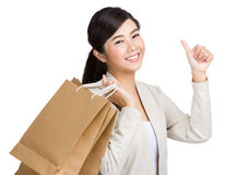 Asian woman thumb up and holding with paper bag Royalty Free Stock Images