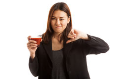 Asian woman thumbs down  hate tomato juice. Royalty Free Stock Photos