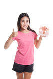 Asian woman thumbs up with a gift box. Royalty Free Stock Photos