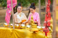Asian woman to Make merit to Buddha statue in thailand royalty free stock image