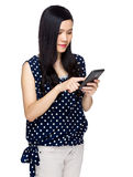 Asian woman touch cell phone Stock Image