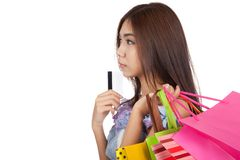 Asian woman touch credit card to chin think what to buy Royalty Free Stock Image