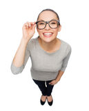 Asian woman in touching eyeglasses Royalty Free Stock Photography